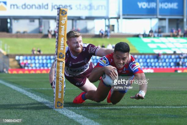 Starford To'a of the Newcastle Knights scores a try during the round 14 NRL match between the Newcastle Knights and the Manly Sea Eagles at McDonald...