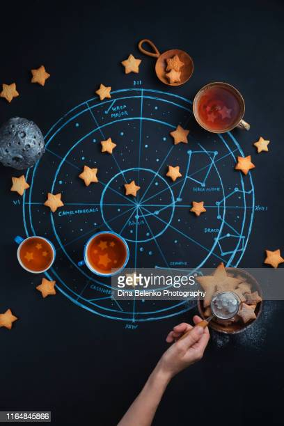 stargazers teatime with astrological and astronomical symbols. chalk map of the starry sky. creative food photography flat lay - astrology stock pictures, royalty-free photos & images