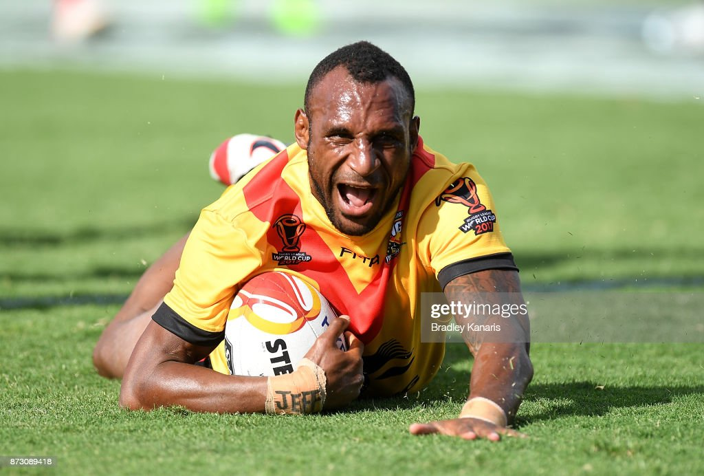 Stargroth Amean of Papua New Guinea scores a try during the 2017 Rugby League World Cup match between Papua New Guinea and the United States on November 12, 2017 in Port Moresby, Papua New Guinea.