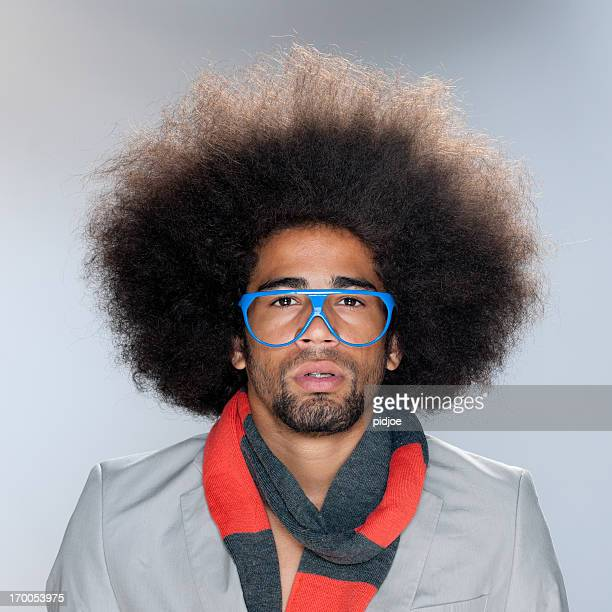 staring man with big afro hair and sunglasses