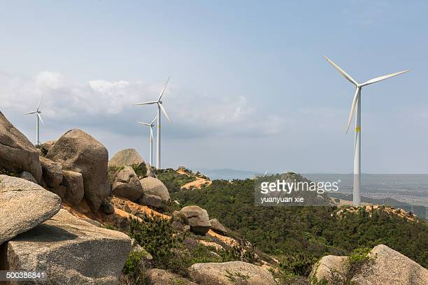 Stark White Electrical Power Generating Wind Turbines on Rolling Hills.z