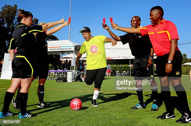 Starkey Hearing Foundation Ambassador Kyle Massey has fun with the referees as he participates in The Special Olympics Unified Sports Experience...