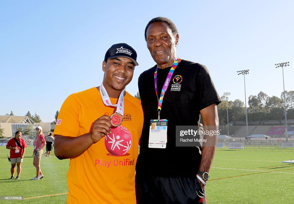 Starkey Hearing Foundation ambassadors Chris Massey (L) and Olympic gold medalist Rafer Johnson participate in The Special Olympics Unified Sports Experience Football Game at UCLA on July 28, 2015 in Los Angeles, California.