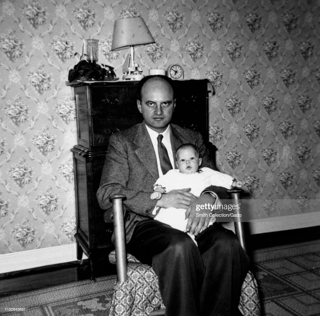 Enjoyable Starkly Lit Portrait Of A Father Sitting In A Rocking Chair Pdpeps Interior Chair Design Pdpepsorg