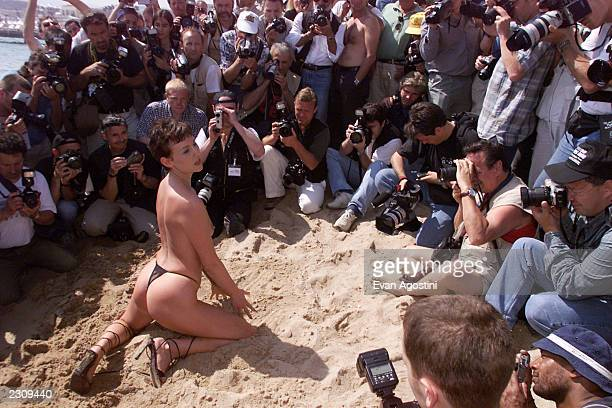 Starlets posing on the beach after the Hot D'or Adult Entertainment Awards luncheon in Cannes France Photo by Evan Agostini/Getty Images