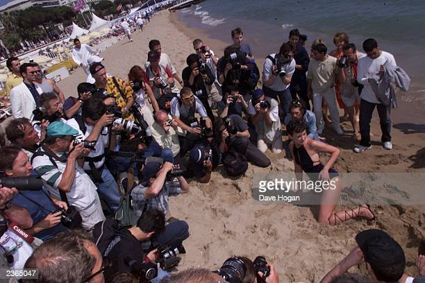 Starlets posing on the beach after the Hot D'or Adult Entertainment Awards luncheon in Cannes France Photo by Dave Hogan/Mission Pictures/Getty Images
