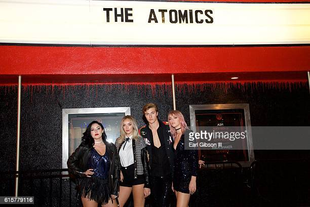 Starlie Smith Daisy Smith Lucky Blue Smith and Pyper America Smith of the band The Atomics pose for a photo before their performance at The Roxy...