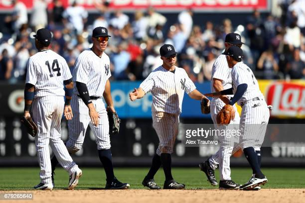 Starlin Castro Aaron Judge Brett Gardner Ronald Torreyes and Jacoby Ellsbury of the New York Yankees celebrate after defeating the Tampa Bay Rays 81...