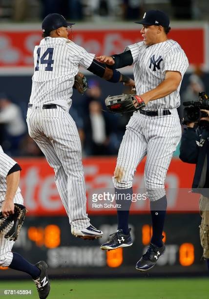 Starlin Castro and Aaron Judge of the New York Yankees celebrate after defeating the Toronto Blue Jays 86 in a game at Yankee Stadium on May 3 2017...