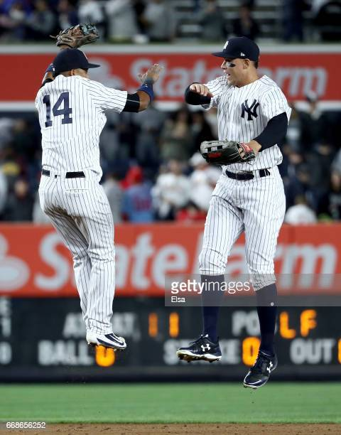 Starlin Castro and Aaron Judge of the New York Yankees celebrate the 4-3 win over the St. Louis Cardinals on April 14, 2017 at Yankee Stadium in the...