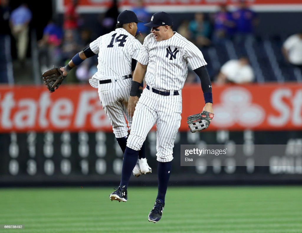 Starlin Castro #14 and Aaron Judge #99 of the New York Yankees celebrate the 9-3 win over the St. Louis Cardinals on April 16, 2017 at Yankee Stadium in the Bronx borough of New York City.