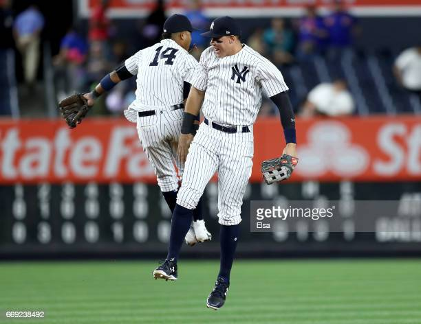 Starlin Castro and Aaron Judge of the New York Yankees celebrate the 93 win over the St Louis Cardinals on April 16 2017 at Yankee Stadium in the...