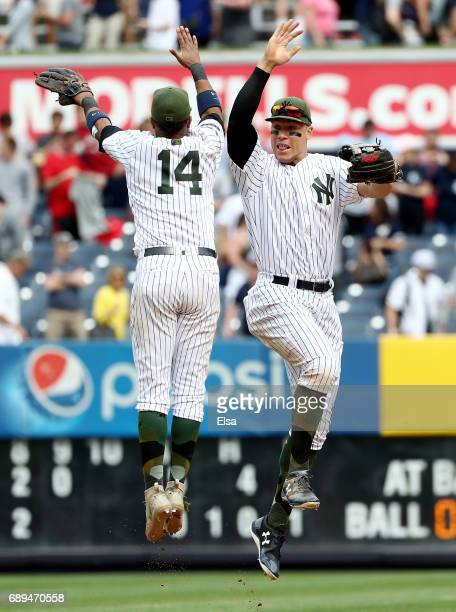 Starlin Castro and Aaron Judge of the New York Yankees celebrate the 95 win over the Oakland Athletics on May 28 2017 at Yankee Stadium in the Bronx...