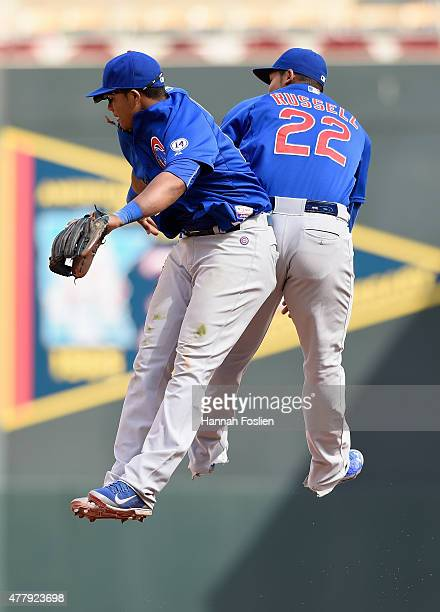 Starlin Castro and Addison Russell of the Chicago Cubs celebrate a win of the game against the Minnesota Twins on June 20 2015 at Target Field in...