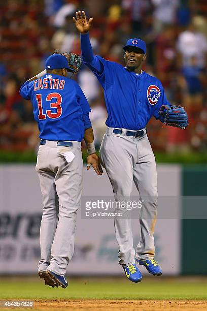 Starlin Castro and Jorge Soler celebrate after beating the St Louis Cardinals at Busch Stadium on August 29 2014 in St Louis Missouri The Cubs beat...