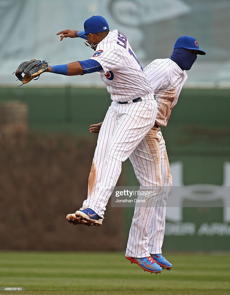 Starlin Castro #13 (L) and Jorge Soler #68 of the Chicago Cubs celebrate a win over the St. Louis Cardinals at Wrigley Field on April 8, 2015 in Chicago, Illinois. The Cubs defeated the Cardinals 2-0.