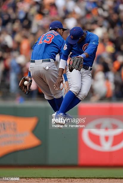 Starlin Castro and Junior Lake of the Chicago Cubs celebrate defeating the San Francisco Giants 2-1 at AT&T Park on July 28, 2013 in San Francisco,...