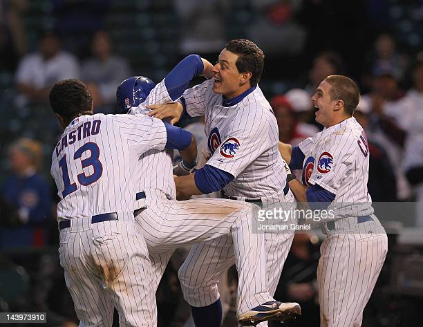 Starlin Castro David DeJesus, Byran LaHair and Tony Campana of the Chicago Cubs celebrate a win over the Los Angeles Dodgers at Wrigley Field on May...