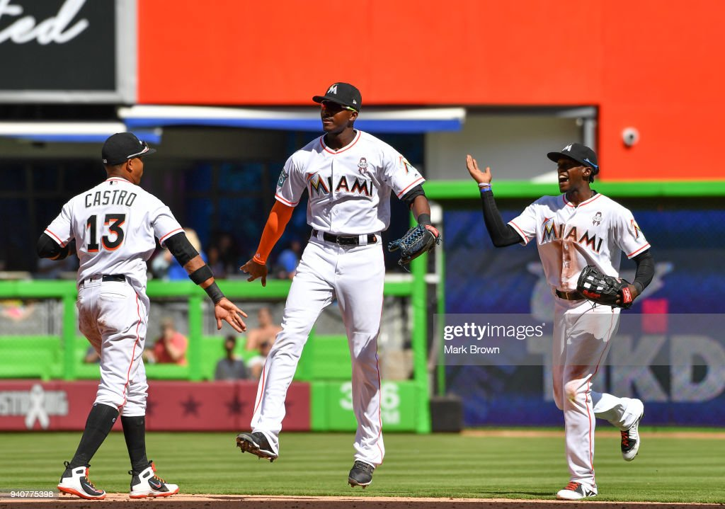 Starlin Castro #13 , Lewis Brinson #9 and Cameron Maybin #1 of the Miami Marlins celebrate after the game against the Chicago Cubs at Marlins Park on April 1, 2018 in Miami, Florida.