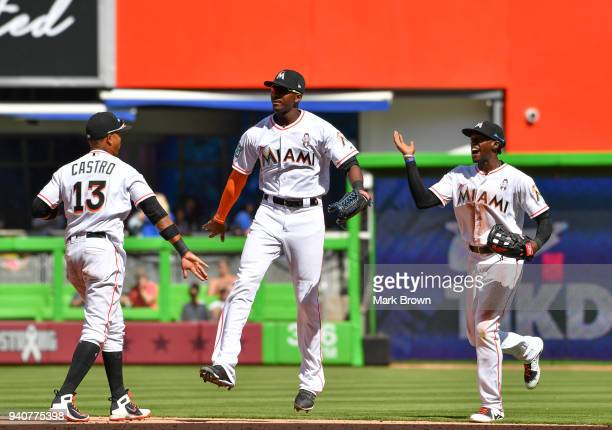 Starlin Castro Lewis Brinson and Cameron Maybin of the Miami Marlins celebrate after the game against the Chicago Cubs at Marlins Park on April 1...