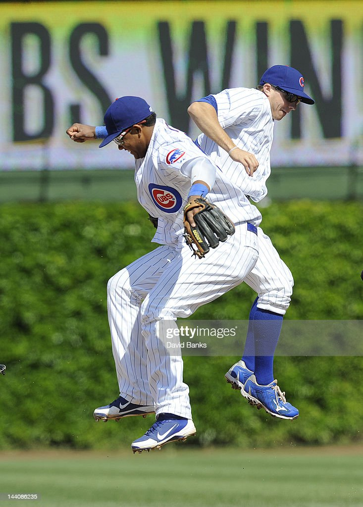 L-R Starlin Castro #13 of the Chicago Cubs and Tony Campana #1 celebrate the Cubs victory against the Atlanta Braves on May 9, 2012 at Wrigley Field in Chicago, Illinois. The Chicago Cubs defeated the Atlanta Braves 1-0.