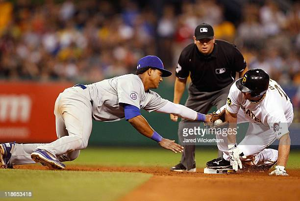 Starlin Castro of the Chicago Cubs attempts to tag Matt Diaz of the Pittsburgh Pirates at second base during the game on July 9 2011 at PNC Park in...