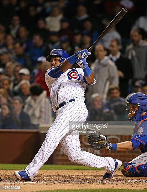 Starlin Castro of the Chicago Cubs blows a bubble while hitting a runscoring double in the 6th inning against the New York Mets at Wrigley Field on...