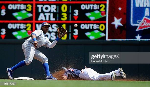 Starlin Castro of the Chicago Cubs catches the ball as Ben Revere of the Minnesota Twins steals second base during the first inning on June 10 2012...