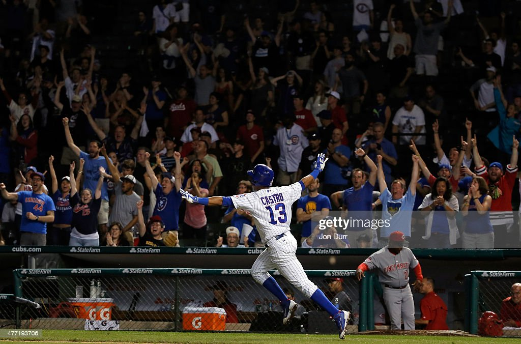 Starlin Castro #13 of the Chicago Cubs celebrates after hitting a walkoff one run RBI single against the Cincinnati Reds during the eleventh inning at Wrigley Field on June 14, 2015 in Chicago, Illinois. The Chicago Cubs won 2-1 in eleven innings.