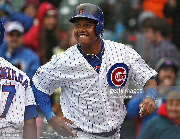Starlin Castro of the Chicago Cubs celebrates after scoring a run in the 7th inning against the St Louis Cardinals at Wrigley Field on April 8 2015...