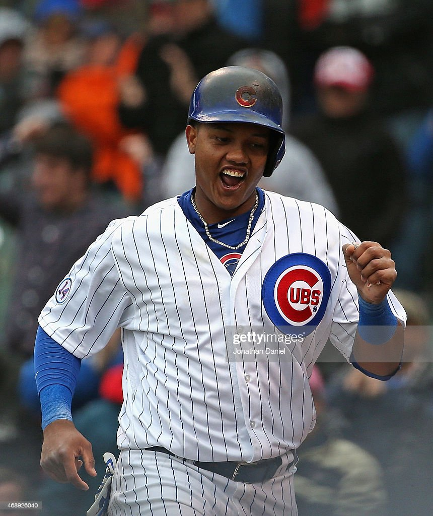 Starlin Castro #13 of the Chicago Cubs celebrates after scoring a run in the 7th inning against the St. Louis Cardinals at Wrigley Field on April 8, 2015 in Chicago, Illinois.