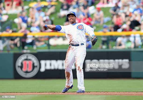 Starlin Castro of the Chicago Cubs fields a ball during the spring training game against the Arizona Diamondbacks at Cubs Park on February 27 2014 in...
