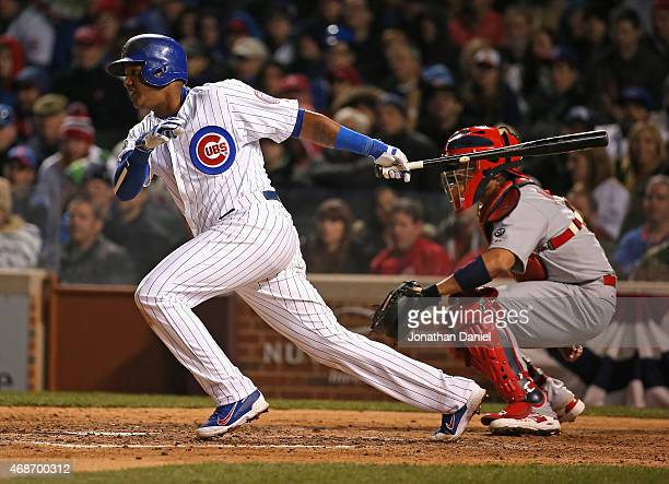 Starlin Castro of the Chicago Cubs hits a single in the 6th inning against the St Louis Cardinals during the Opening Night game at Wrigley Field on...