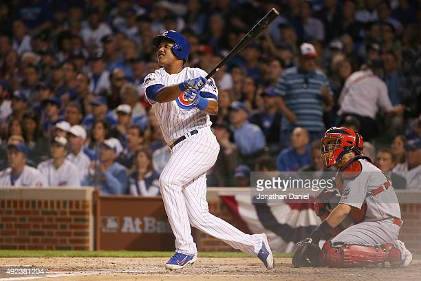 Starlin Castro of the Chicago Cubs hits a solo home run in the fourth inning against the St Louis Cardinals during game three of the National League...