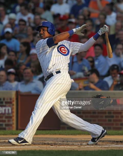 Starlin Castro of the Chicago Cubs hits a tworun home run in the 1st inning against the Philadelphia Phillies at Wrigley Field on July 19 2011 in...