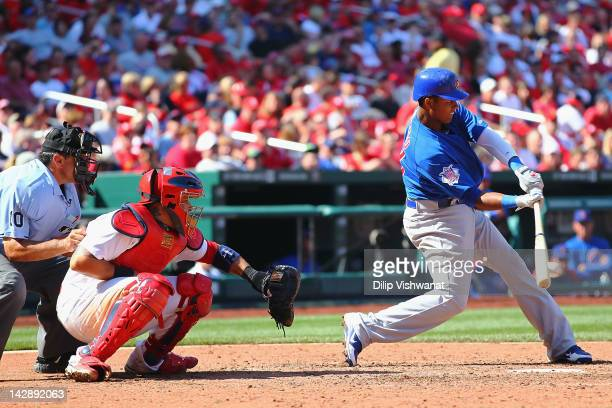 Starlin Castro of the Chicago Cubs hits an RBI single against the St. Louis Cardinals at Busch Stadium on April 14, 2012 in St. Louis, Missouri.
