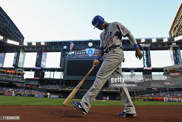 Starlin Castro of the Chicago Cubs knocks dirt from his shoes as he walks up to the on deck circle during the Major League Baseball game against the...