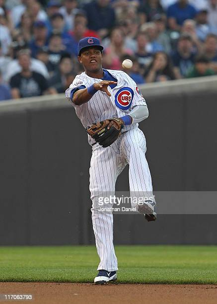 Starlin Castro of the Chicago Cubs leaps to make a throw to 2nd base against the New York Yankees at Wrigley Field on June 19, 2011 in Chicago,...