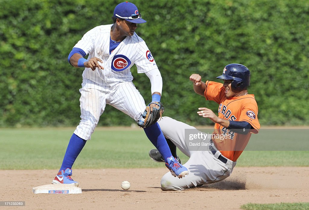 Starlin Castro #13 of the Chicago Cubs makes an error on a force play on Justin Maxwell #44 of the Houston Astros during the ninth inning on June 23, 2013 at Wrigley Field in Chicago, Illinois. The Chicago Cubs defeated the Houston Astros 14-6.