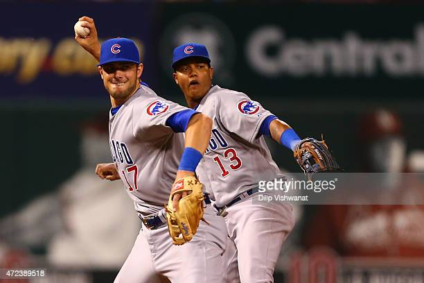 Starlin Castro of the Chicago Cubs mimics Kris Bryant of the Chicago Cubs as Bryant throws a runner out at first base against the St. Louis Cardinals...