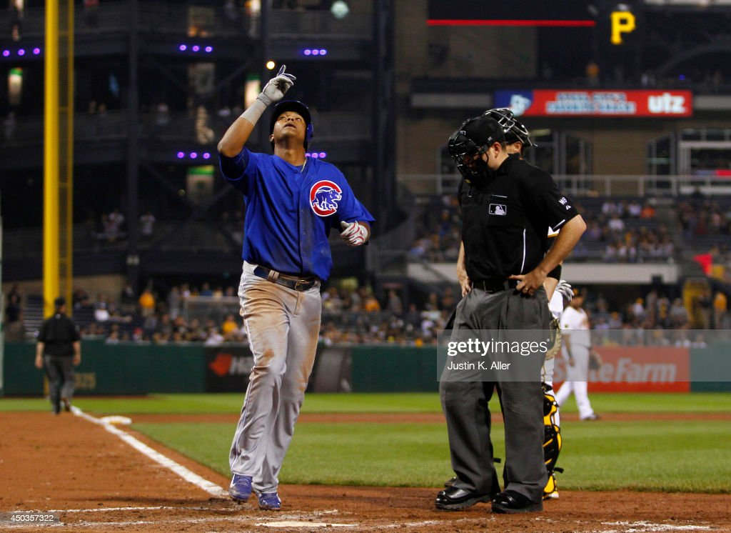 Starlin Castro #13 of the Chicago Cubs reacts after hitting a home run in the ninth inning against the Pittsburgh Pirates during the game at PNC Park on June 9, 2014 in Pittsburgh, Pennsylvania.