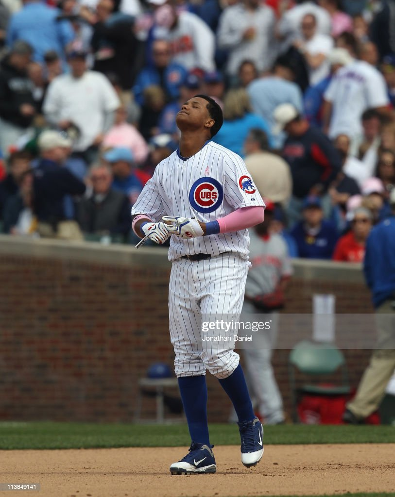 Starlin Castro #13 of the Chicago Cubs reacts after making the third out in the 7th inning with the bases loaded against the Cincinnati Reds at Wrigley Field on May 8, 2011 in Chicago, Illinois. The Reds defeated the Cubs 2-0.