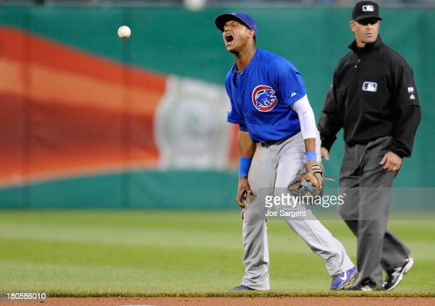 Starlin Castro of the Chicago Cubs reacts after misplaying a ball hit by Justin Morneau of the Pittsburgh Pirates on September 14 2013 at PNC Park in...