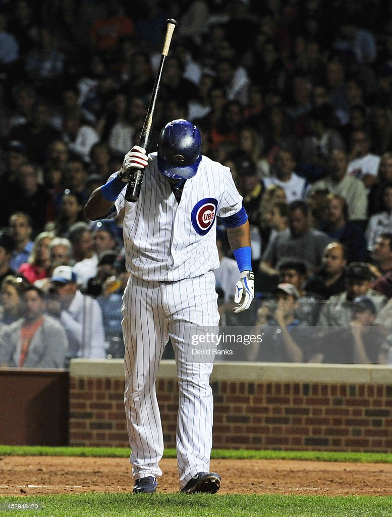 Starlin Castro #13 of the Chicago Cubs reacts after striking out against the Colorado Rockies during the sixth inning on July 30, 2014 at Wrigley Field in Chicago, Illinois.
