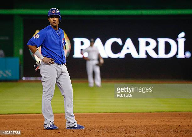 Starlin Castro of the Chicago Cubs stands just off second base after getting a double during the sixth inning of the game against the Miami Marlins...