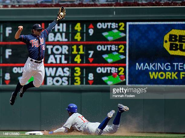 Starlin Castro of the Chicago Cubs steals second base as Brian Dozier of the Minnesota Twins catches the ball during the eighth inning on June 10...