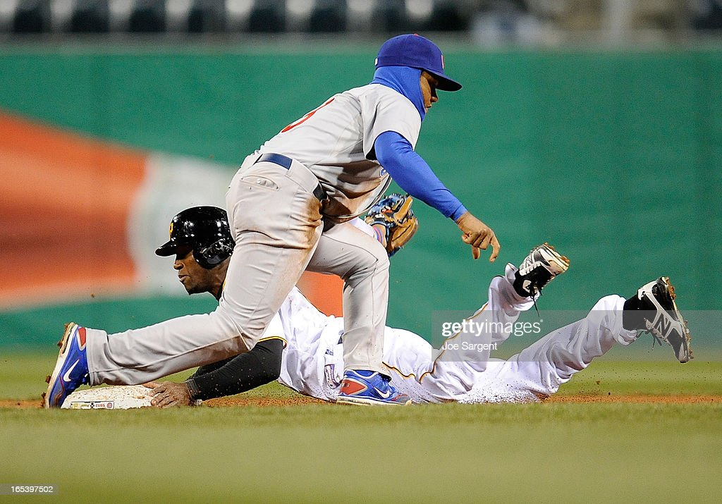 Starlin Castro #13 of the Chicago Cubs tags out Starling Marte #6 of the Pittsburgh Pirates during a steal attempt in the seventh inning on April 3, 2013 at PNC Park in Pittsburgh, Pennsylvania. Pittsburgh won the game 3-0.