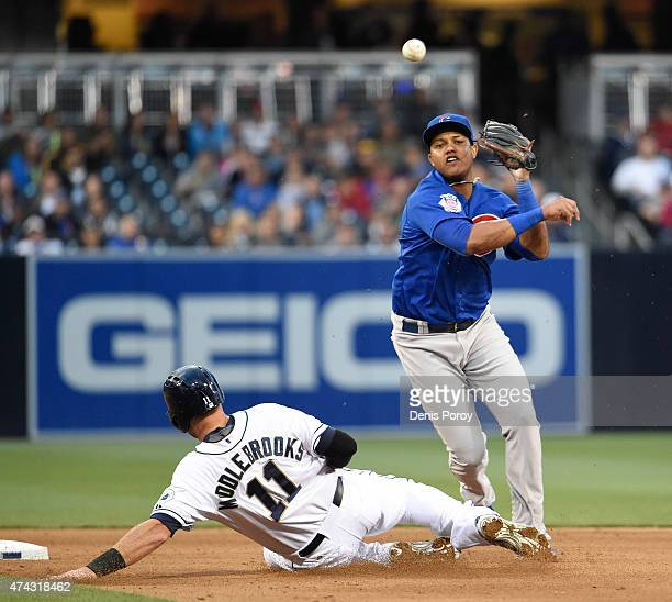 Starlin Castro of the Chicago Cubs throws over Will Middlebrooks of the San Diego Padres as he turns a double play during the fifth inning of a...