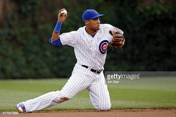 Starlin Castro of the Chicago Cubs throws to first base for the out against the Cincinnati Reds during the first inning at Wrigley Field on June 13...