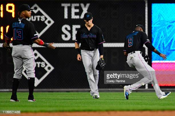 Starlin Castro of the Miami Marlins Brian Anderson and Lewis Brinson can't communicate to catch a fly ball against the Philadelphia Phillies during...